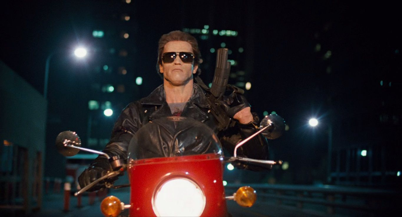The Terminator 1984 young Arnold Schwarzenegger driving a red moto