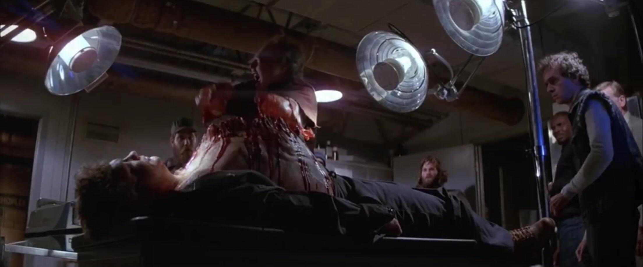 The Thing 1982 scene dead bed